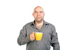 The bald man with a cup. The person with a mug isolated background Royalty Free Stock Image
