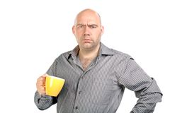 The bald man with a cup. The person with a mug isolated background Stock Photos