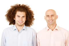 Bald man, curly hair man. Portrait of a bald man and a man with long curly hair.  Theme:  Opposites Royalty Free Stock Images