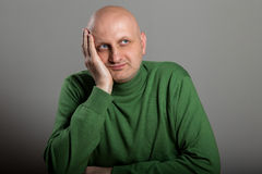 Bald Man with doubtful expression royalty free stock photography