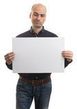 Bald man with expressive gestures holding a banner Royalty Free Stock Photography