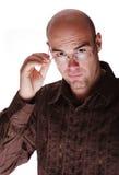Bald man with eyeglasses. Bald man in brown shirt with eyeglasses Stock Image