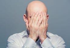 Bald man face closed hands Stock Photography