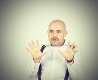 Bald man feels awkward, anxiously isolated. Fear phobia Stock Images