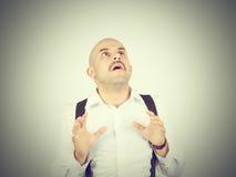 Bald man feels awkward, anxiously isolated. Fear phobia Royalty Free Stock Photography