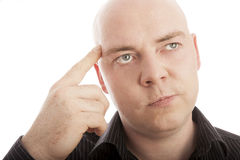 Bald man with finger thinking Stock Image