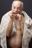 Bald Man Flossing His Teeth Stock Images