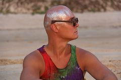 Bald man freak in bright clothes and round glasses at a freak pa royalty free stock images