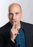 Bald man with a gesture of shh Stock Photo