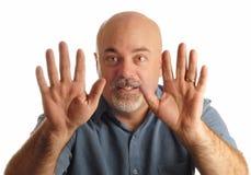 Bald man gesturing to stop. Bald man holding up hands gesturing stop Stock Photos