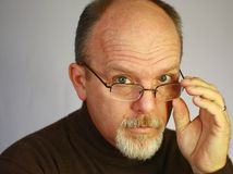 Bald man with glasses Stock Image