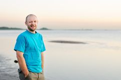 Bald man having by the sea. Bald man having fun by the sea Stock Images