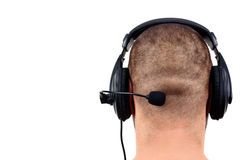 Bald man with headphones Stock Images