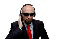 A bald man with headphones, white background, isolate, special agent, spy royalty free stock photography