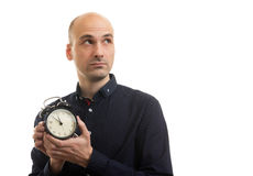 Bald man holding alarm clock Stock Photo