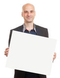 Bald man holding a blank sheet of paper Stock Photography