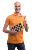 Bald man holding a chess board Stock Photography