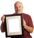 Bald man holding picture Royalty Free Stock Photos