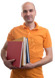 Bald man holding some books Stock Photo