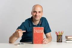 Bald man learning English Royalty Free Stock Photography