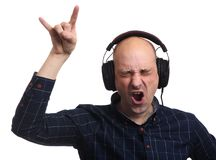 Bald man listening music with headphones. Isolated Stock Images