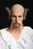 Almost bald man with long moustache in baroque dress Royalty Free Stock Photos