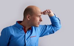 Bald man looking for something Stock Images
