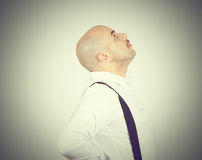 Bald man looking up. Side view. Thoughts, ideas Royalty Free Stock Images