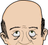 Bald Man Looks Up. Cropped face of bald Caucasian man looking up Stock Images