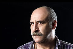 Bald Man with Mustache Confusing. Bewilderment. Portrait of bald man with a big mustache expressing uncertainty and fear Royalty Free Stock Photography