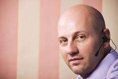Bald man operator support stock photos