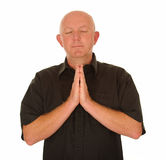 Bald man praying Stock Images
