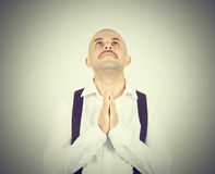 Bald man praying,imploring, hands clasped hoping of miracle Stock Images