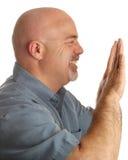 Bald man pushing something stock photos