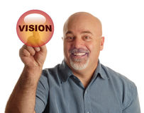 Bald man pushing vision button. Bald man pointing at button that says vision Royalty Free Stock Photo