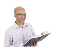 Bald man reading a book Stock Photo