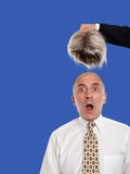 Bald man revealed by removing the toupee Royalty Free Stock Photography