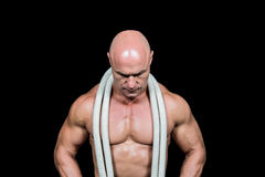 Bald man with rope around neck Stock Image