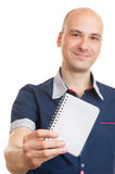 Bald man showing a blank notepad Stock Image