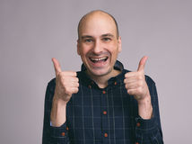 Bald man shows sight thumbs up Stock Photography