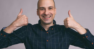 Bald man shows sight thumbs up. Happy funny bald man shows sight thumbs up Stock Images