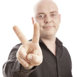 Bald man with sign victory Stock Photos