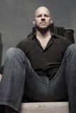 Bald man sitting Royalty Free Stock Images