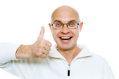 Bald man smiling with thumb up. Isolated on white. Studio Royalty Free Stock Photos