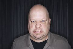 Bald man sneering. Stock Photos