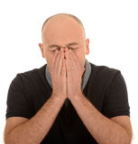 Bald man sneezing Royalty Free Stock Photo