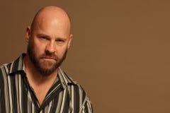 Bald man in a striped shirt Stock Photos