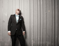 Bald man in a suit Stock Image