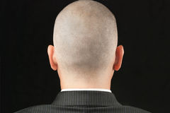 Bald Man in Suit From Behind Stock Image