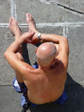 Bald man sunbathing Stock Image